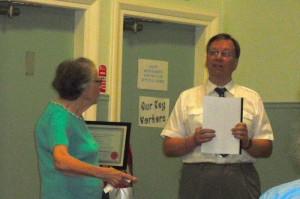 Edna receiving honorary membership from Chairman Ray Smith